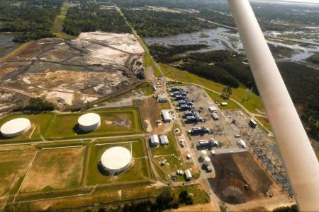 coal toxins, energy giants, ash cleanup, costs