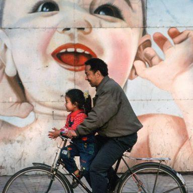 Chinese man, child, billboard