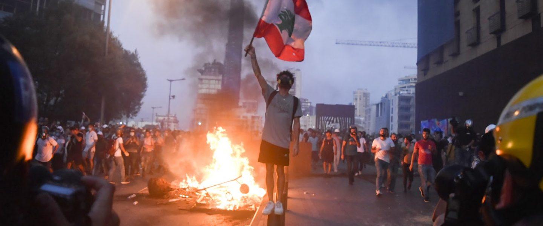 demonstrator, waves flag, Beirut, Lebanon