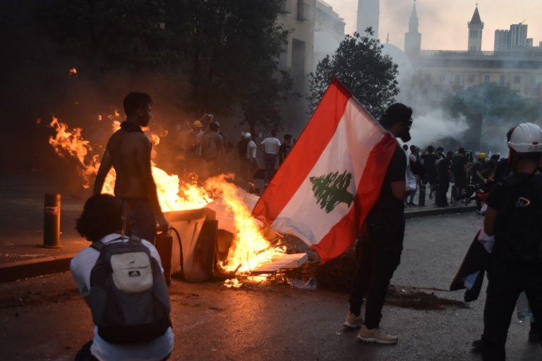 man holds flag, Beirut, Lebanon