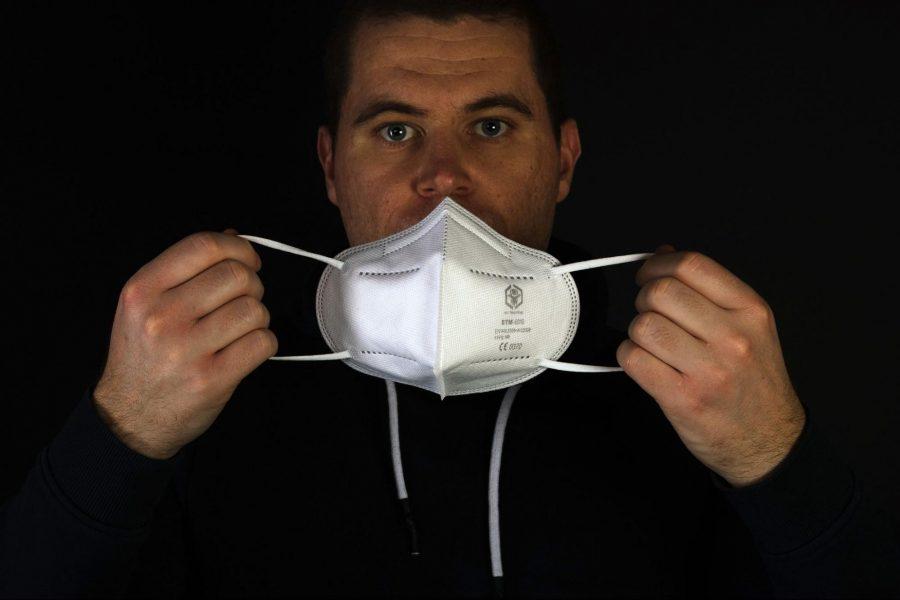 man, putting mask on